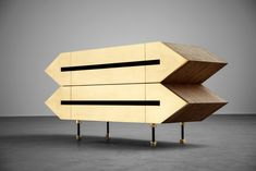 Designer sideboard / media cabinet - wooden furniture influenced by dystopia and retro sci-fi movie scenography - brutalist form expressed in sharp lines and triangles. Here shown in brushed oak wood finish and raw brass metal finish.