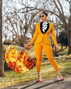 The vibrant color options available in this bold and edgy pantsuit-set is the perfect statement-making look for any meeting, date-night, brunch, or just because you call the shots!