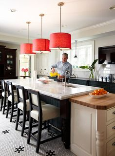 Love the gorgeous red pendant lights.  Very striking!