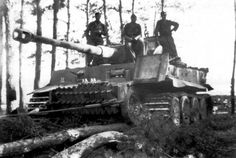 "A Das Reich Tiger I crew ""short track"" their tank in order to move it...The drive sprocket is removed so that the transmission gears do not move while the tank is moved."