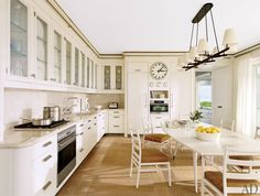 Large white kitchen and dining area. Very light and airy nice use of space. #kitchen #white #diningroom