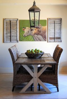 chairs at lakehouse; love the cow picture with shutters..just like looking out the window and seeing the pasture!!