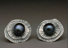 Wendy Thurlow's jewelry is organic and sculptural. Her primary focus has been the use of mixed metals with semiprecious stones, fossils and found objects. Her eye for composition, attraction to form and design, enable her to create jewelry of distinct style.