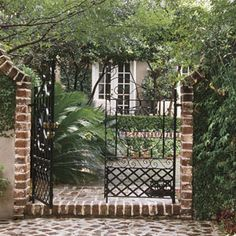 An open iron gate bids you welcome. Like many gardens in historic Charleston, this one entices at first glance and then surprises with details. A series of discrete spaces is defined by paving and planting beds.