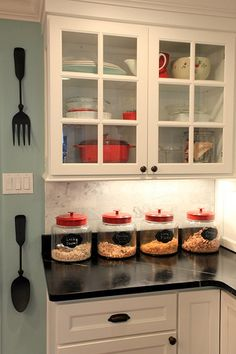 http://www.many-muses.com  Kids' Self Service Cereal Bar. I love the color scheme: grey, white and pops of red. I also see some hints of robins egg blue/teal.
