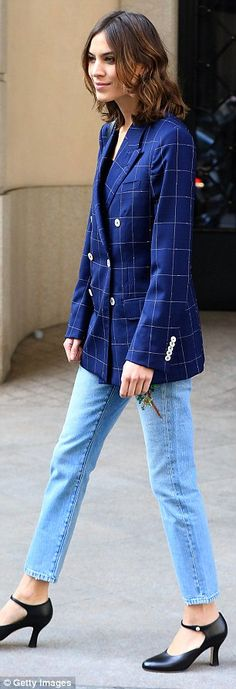 Style icon: The designer wore a double-breasted checked navy blazer with light blue jeans ...