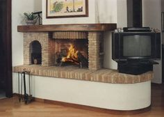 Camini rustici, lavorazione artigianale con pietre, mattoni e legno
