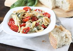 Orecchiette with slow roasted tomatoes & artichokes... this looks so amazing.