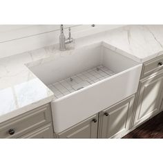 Add traditional flair to your kitchen with a Randolph Morris farmhouse sink with stainless steel sink grid to help prevent scratches and keep your sink in tip-top shape. The smooth apron design makes this farm sink perfect for any style kitchen. Fireclay Farmhouse Sink, Fireclay Sink, Farmhouse Sink Kitchen, New Kitchen, Kitchen Ideas, Kitchen Reno, Kitchen Designs, Butler Sink Kitchen, Kitchen Interior