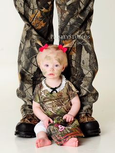 camo baby.. Cute idea for a dad and daughter picture.  I may just let my husband do this...once...