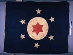 """TSLAC 306-4065 Second Florida Special Battalion. This large flag belonged to the 2nd Florida Special Battalion, which was assigned to the defense of Fort Brooke, whose guns overlooked Tampa Bay. Much of what is known about this flag is tentative. It is now thought that this flag, along with the St. John's River flag (TSLAC 306-4062), were constructed about the same time from blue cloth ordered from a mill in Madison County, Florida. The flag is inscribed on the edge with the words """"Captured…"""