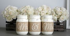 This particular set of rustic wedding or engagement party table centerpieces feature pint sized Mason jars expertly hand painted, lightly...