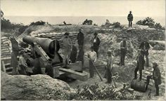 Defenses Around Mobile, Alabama  Here a Confederate camera has caught the spirit of the Southern soldiers at the outbreak of the war. These are Captain G. W. Dowson's Perote Guards manning the Perote Sand Batteries at Mobile, January, 1861. On the 11th of January, 1861, the ordinance of secession was passed by the Alabama convention at Montgomery