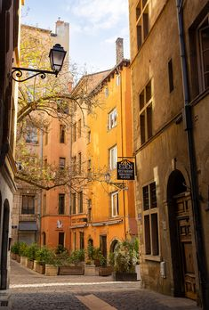 Eden - Colorful Rue de Boeuf in Vieux Lyon, the old town of the city of Lyon, on a spring morning.