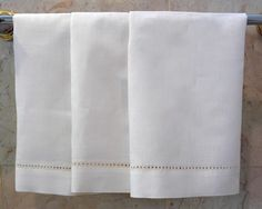 """Pretty enough for everyday use. This 14x22"""" galloucci hand towel is a great way to welcome your guest in style. Imported. 100% Linen. Color: Ecru. Available also in dinner napkins, cocktail napkins, placemats, runners and tablecloths."""