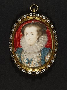Interesting hair.  Very pretty embroidered jacket and coordinating necklace+overgown.  An Unknown Lady by Isaac Oliver at the V  1615.  Height: 54 mm, Width: 43 mm.