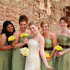 Each of Emily's four bridesmaids wore a strapless, tea-length, Ann Taylor dress in sage green with a chocolate brown sash. They completed the look with a pair of their own silver shoes.