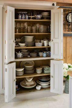 Generous bi-fold larders with adjustable shelves were to designed to resemble a Victorian bookcase.