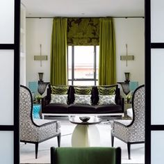 The palette designer Mark Gillette chose for his flat in Manchester has a distinct art-deco reference, with a jewel-like array of jade and aquamarine paired with black and white. Mark extended the curtain pole round the perimeter of the room to give the space visual unity, using 25mm steel poles and 'Passing' ceiling brackets from The Bradley Collection.