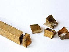 IndustRing, by Israel's Dana Bachar-Schneorson. Cuts rectangular brass tube at different angles then reconnects pieces