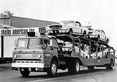 1966 Ford C600 COE tractor, pulling a load of Shelby Mustangs on a fifth wheel car hauler
