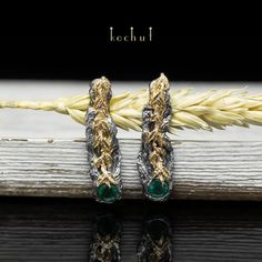 "Unusual handmade earrings of author's design ""The power of life"". The base is made of silver of 925 samples, leaves - gold of 585 tests. These powerful earrings are made with natural green emeralds (diameter - 5 mm)."