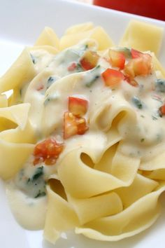Recipe including course(s): Entrée; and ingredients: baby spinach, garlic cloves, mozzarella cheese, olive oil, pasta, ricotta cheese, salt, tomato