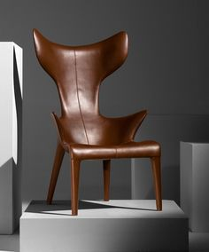 french designer philippe starck has created an armchair with an organic, anthropomorphic outline. the 'lou read' armchair is part of a collection for paris's royal monceau hotel, recently refurbished by starck, where it is placed in every room. 15 years ago, starck met lou reed in this hotel.