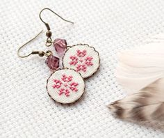 These earrings in ethnic style were embroidered with delicate dusty pink cotton embroidery floss on white linen fabric. These Tribal earrings were inspired by traditional Ukrainian embroidery and are