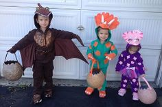 All three kids in dinosaur costumes