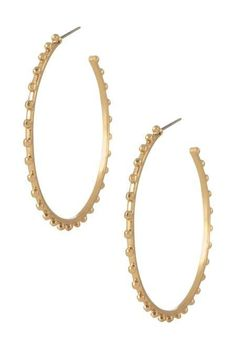 These semi-shiny gold hoops are perfect for any occasion and any outfit. Bring style to all of your outfits with these shiny hoop earrings from Stella & Dot.