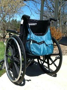 Explorista crossbody snaps onto a wheelchair, stroller, or grocery cart!