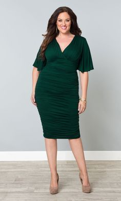 Flaunt your curves in our green plus size Rumor Ruched Dress!  This body con dress is fully ruched in a soft jersey material to flatter and keep you comfortable.  Browse our entire made in the USA collection online at www.kiyonna.com.  #KiyonnaPlusYou