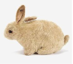 A Steiff white rabbit  with black boot button eyes, pink velvet lining to ears, pink stitched nose and mouth and button in ear 7½in. long, circa 1910.