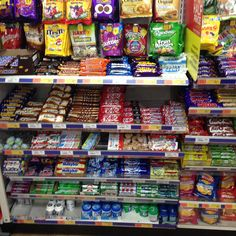 #confectionery display shelving #sweet display shelving #Newsagent sweet retail shelving. Metal shelving that is perfect for convenience shops, newsagents, supermarket display shelving. complete with front risers and dividers for displaying your sweets and chocolates for maximum impact.