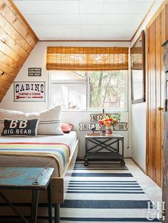 This compact bedroom has the appearance of a cozy attic hideaway or a guest room in a forrest cottage—the angled wall, stepped ceiling, and wood pla. Attic Apartment, Attic Rooms, Attic Bathroom, Bathroom Baskets, Attic House, Attic Closet, Attic Playroom, Apartment Living, Attic Renovation