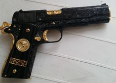 Versace discovered by 𝓔𝓵𝓵𝓮𝓷💎 on We Heart It Weapons Guns, Guns And Ammo, Rifle, Colt 1911, Custom Guns, Cool Guns, Screwed Up, Survival Skills, Mafia