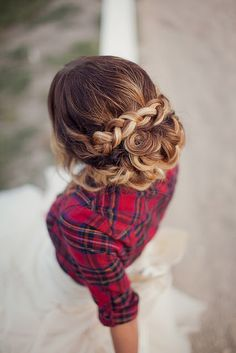 Updo braid. Her highlights make the braid and curls stand out more as subtle swirls of hair instead of the curl effect. Nice touch.