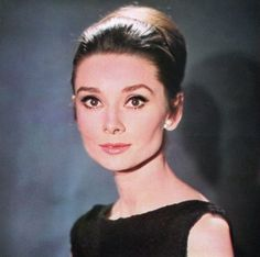 """The actress Audrey Hepburn photographed by Vincent Rossell at the Studios de Boulogne, located on Avenue Jean-Baptiste-Clément, in Boulogne-Billancourt, a French commune in the Hauts-de-Seine départment, region of Île-de-France, in the western suburbs of Paris, during a photo shoot for the publicity material of her new movie """"Charade"""", in January 1963.Audrey was wearing:Cocktail dress: Givenchy (of black cloqué silk, sleeveless and with a high boat neckline in front that plunges to a deep…"""