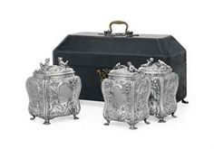 A GEORGE III SILVER TEA CADDY SET IN FITTED CASE MARK OF THOMAS PITTS, LONDON, 1760 Each bombé form, on four shell feet, the sides and covers embossed with chinoiserie and rococo motifs and two vacant cartouches, each cover with seated tea drinker and bird and branch finial, marked under each base and cover bezel; the black leather case mounted with brass furniture and lined with red velvet The largest 5¼ in. (13.1 cm.) high; 28 oz. 10 dwt. (891 gr.) (4)