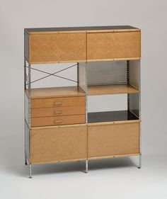 """Charles Eames (American, 1907-1978) and Ray Eames (American, 1912-1988), Eames Storage Unit (ESU), 1950. Plastic-coated plywood, lacquered masonite, and chrome-plated steel, 58 1/2 x 47 x 16 3/4"""" (148.6 x 119.4 x 42.5 cm). Manufactured by Herman Miller, Inc., Zeeland, MI."""
