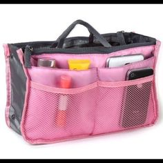 """Purse organizer - pink Purse Organizer  Description: This organizer can be used to store all of your trinkets, and is made out of fabric to fit easily into your purse, car, desk, or suitcase. An organized bag equals a organized mind!  Highlights: • Made of easy care cotton and polyester • Multiple pockets to classify your personal stuff • Perfect for holding cosmetics, phone, books, travel goods • Measures approx 11.25"""" x 6.7"""" x 3.9"""".         ****inside of bag is black....color shown is just…"""