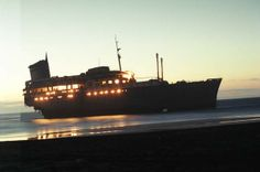 The bow of the S.S. America eerily aglow in the sun on the Canary Islands, ca. 2004.