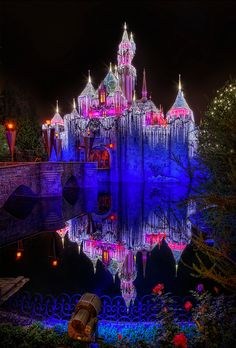 Sleeping Beauty Castle in Disneyland.  I LOVE, LOVE, LOVE everything about this picture! The reflection is the water is awesome!