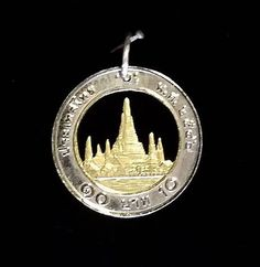 Thailand cut coin pendant silver and brass material can be found for sale at:   https://www.etsy.com/au/shop/ChronicSmithing?ref=search_shop_redirect