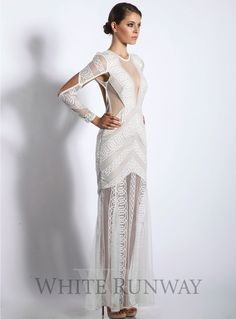 Ivory Ambrosia Maxi. A sexy full length dress by Shona Joy. A high neck style with mesh plunged V-neck. Features a mini lining with sheer ivory lace overlay.