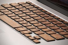 Unnecessary but beautiful....LOVE these!  Wooden MacBook Pro Keycaps by Lazerwood Industries