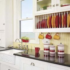 DIY Kitchen Storage Solutions: I want to use the plate rack cabinet insert,   utensil/measuring cup cabinet door hangers, peg rack for lid storage, cutting board storage rack, and tension rods to divide pans & trays.