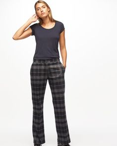 A new fabric for the season, these pants are made from a virgin wool mix with a touch of silk, and feature a plaid design. Tailored for a contemporary fit with a slightly wider leg than some of our slim-fitted styles, they feature press crease detailing, concealed zip and hook-and-bar closure, and slant and jetted pockets. Wear with a silk top or blouse.