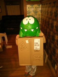 Cut the Rope Halloween costume. I made Om Nom out of paper mache ... And the box out of a cardboard box.